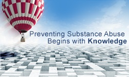 "A red and white checkered hot-air balloon is rising up toward the right, above a complex maze below. A slogan to the right of the balloon says, ""Preventing Substance Abuse Begins with Knowledge"