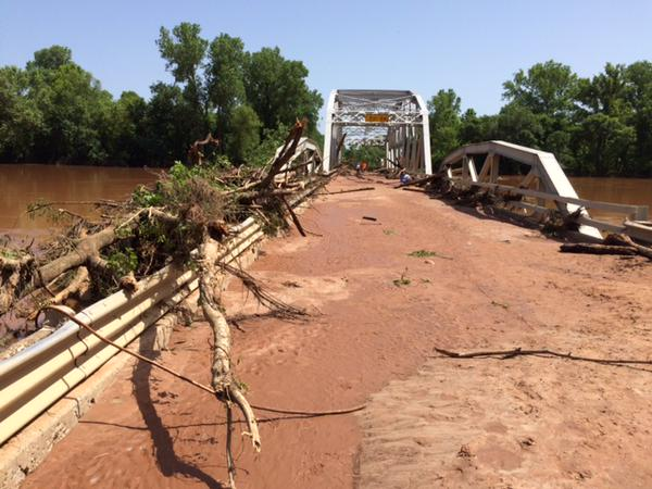 Flooding damages bridge in Oklahoma; photo courtesy @OKDOT.