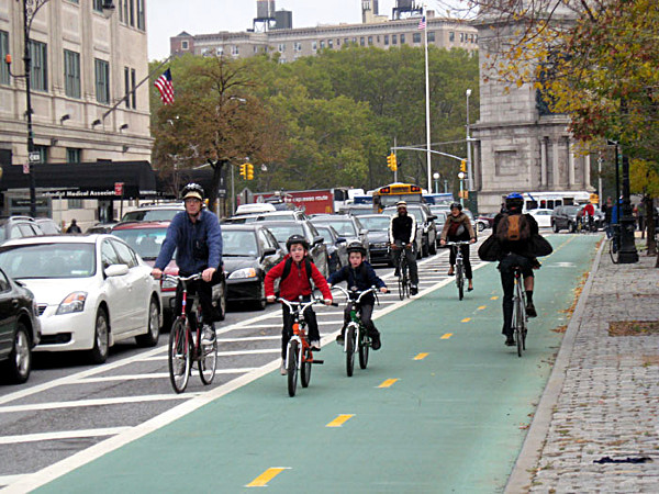 Photo of riders in a protected bike lane