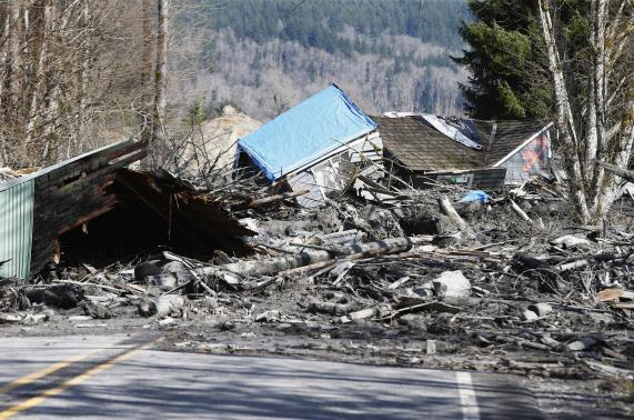 Photo of debris blocking state Route 530, credit Lindsey Wasson / Reuters