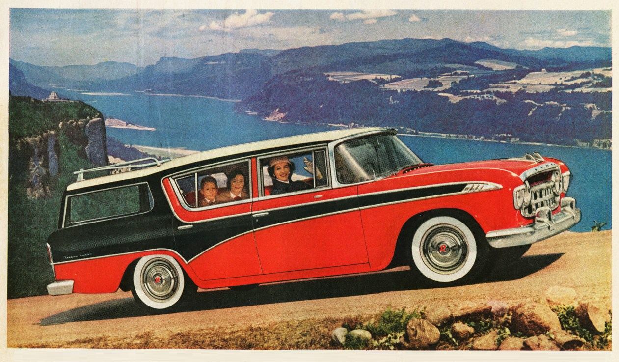 Vintage post card with red station wagon