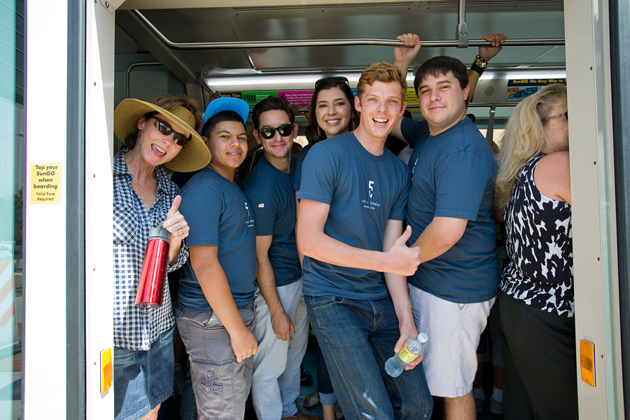 Photo of happy riders on Sun Link