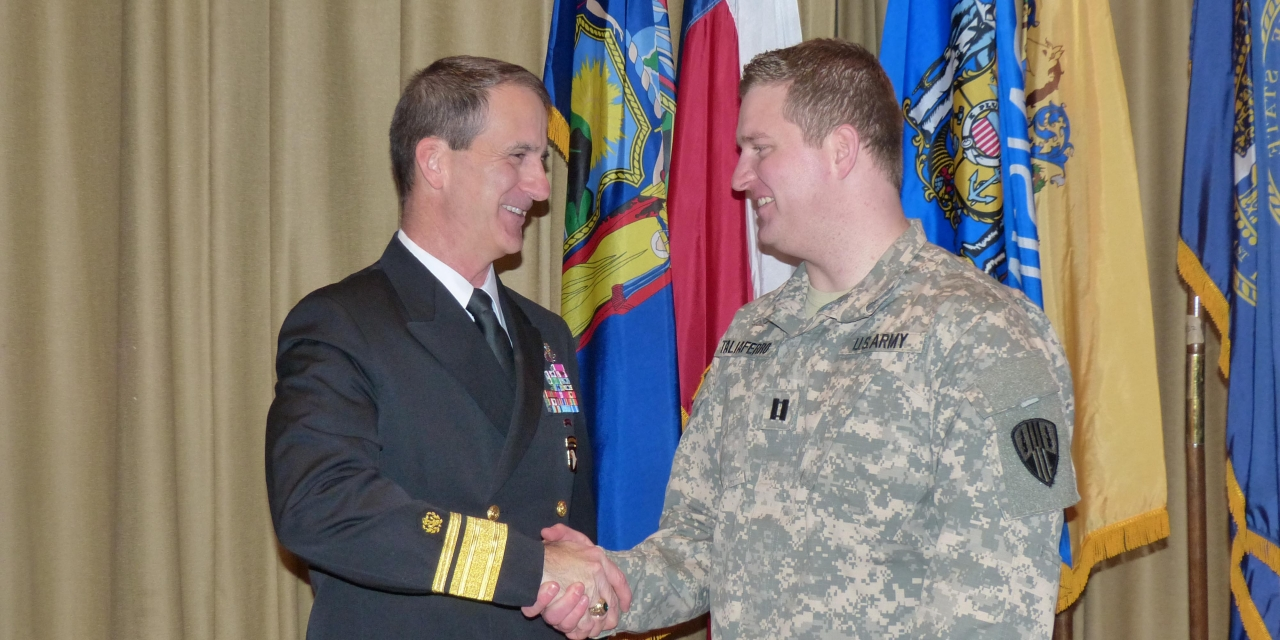 Photo of RADM Helis and Cpt. Taliaferro