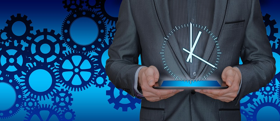 Man holding a virtual clock with gears in the background