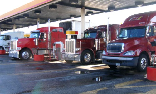 Photo of trucks at a gas station