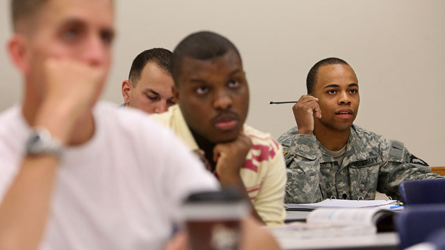 Photo of college classroom with students, some veterans