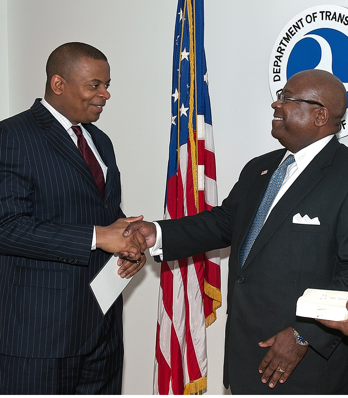 Secretary Foxx shaking hands with Greg Winfree