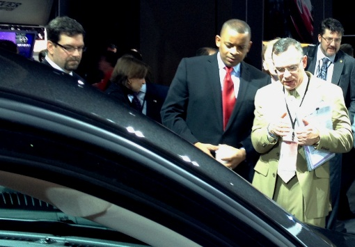 Photo of Secretary Foxx viewing the Chrysler display