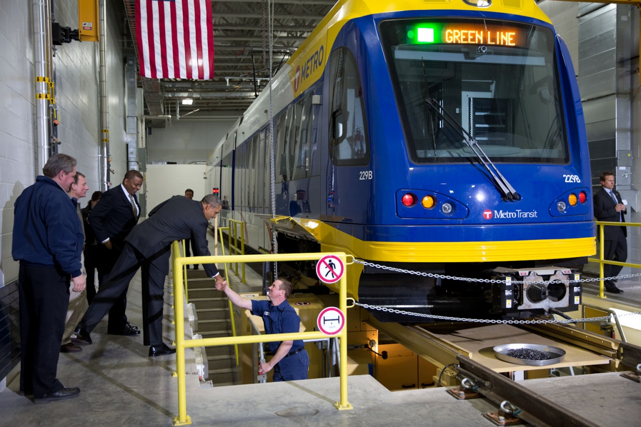 President Obama and Sec Foxx tour Metro Transit maintenance shop