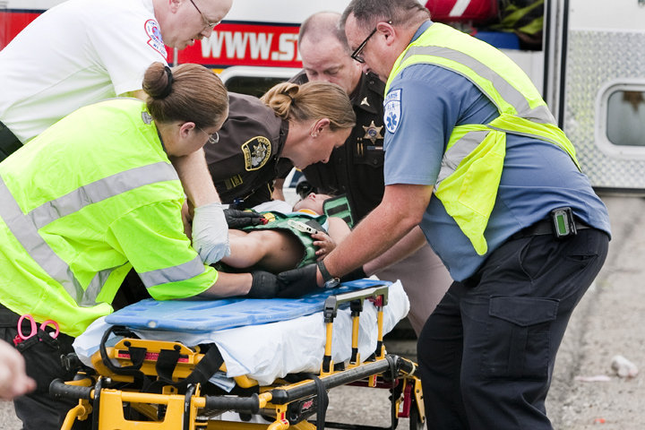 Photo of child on stretcher after crash