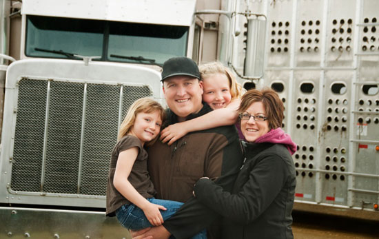 Photo of a truck driver and his family
