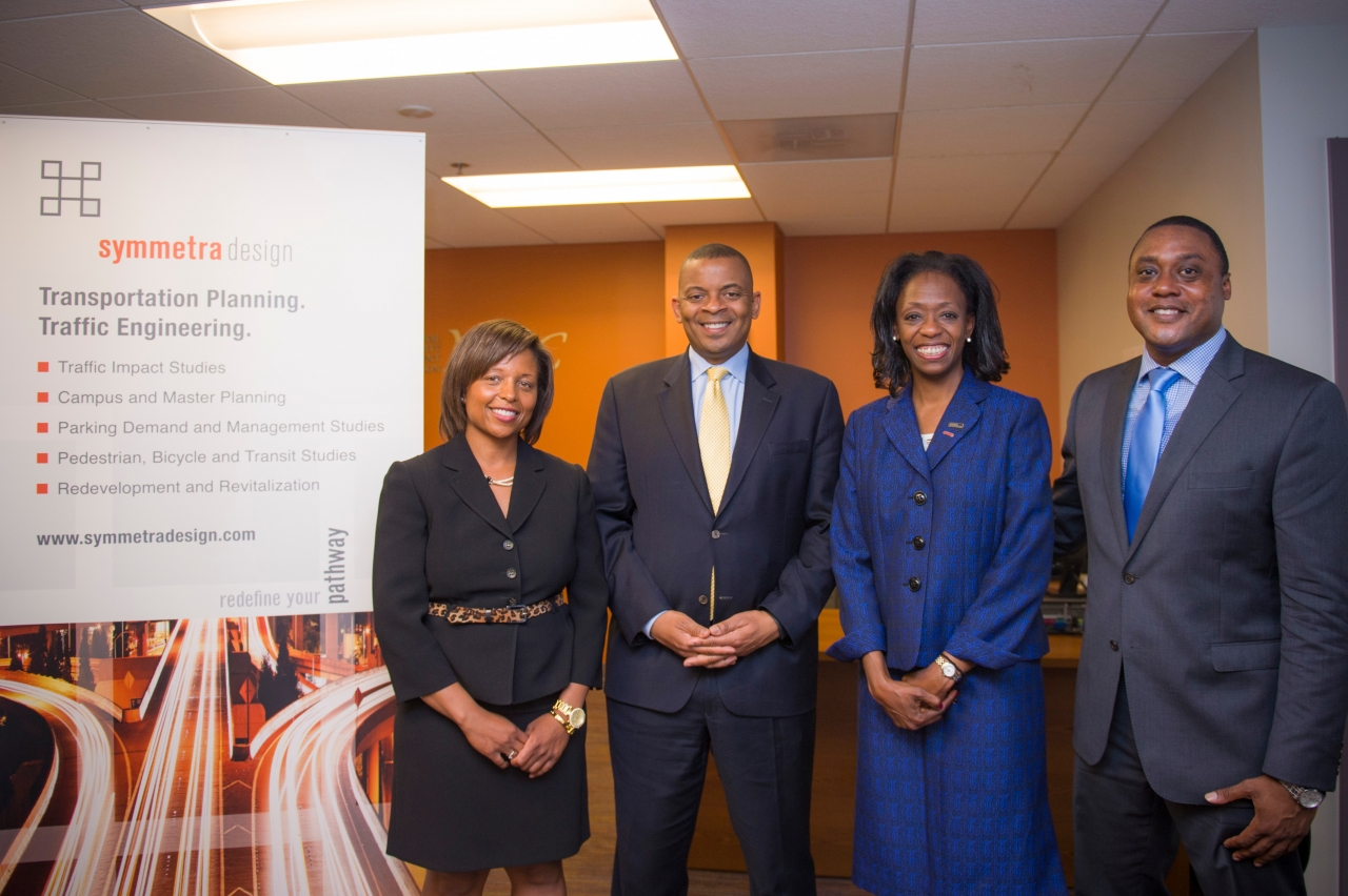 Photo of Secretary Foxx and O.S.D.B.U. Director Brandon Neal meeting with Symmetra