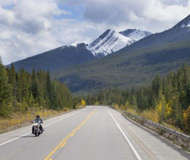 A motorcycle with mountains in the foreground.