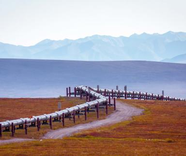 A pipeline with mountains in the background.