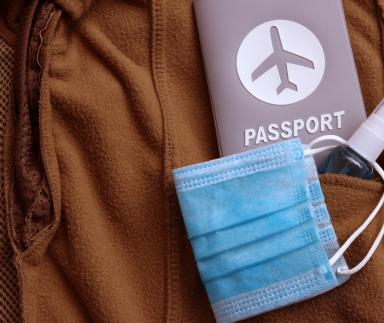Mask, passport and hand sanitizer