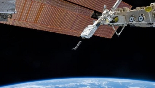 Picture of an airf orce satellite just above earth's atmosphere