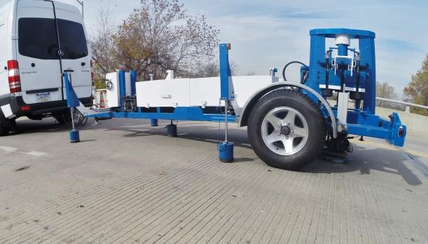 image of blue apparatus used on bridge to test load capacity