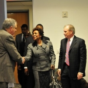 DOT Secretary Ray LaHood greets U.S. Congresswoman Yvette Clarke, and CEO of Parsons Brinckerhoff, George Pierson